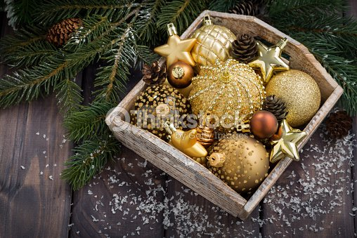 wooden box with golden christmas decorations on table top view stock photo - Wooden Box Christmas Decorations