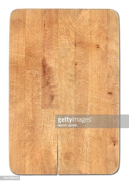 Wooden bread cutting board isolated on white, knife's cuts visible