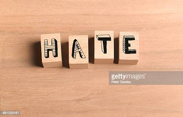 Wooden bricks spelling out word hate