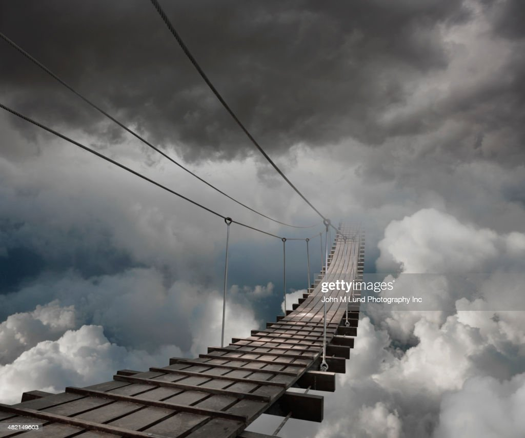 Wooden bridge in clouds