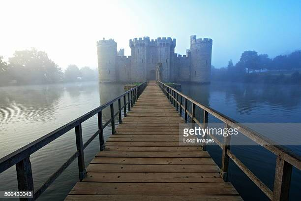 Wooden Bridge leading over the moat to Bodiam Castle an almost perfect example of a 14th century medieval castle