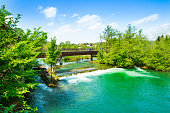 Panoramic view on waterfall and wooden bridge on Mreznica river in Belavici, Croatia