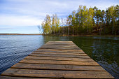 Wooden bridge over a tranquil lake