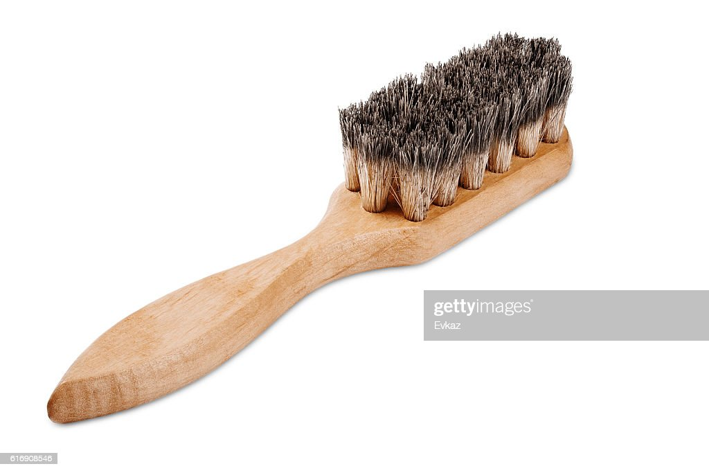 wooden brush with bristles on isolated white background : Stock Photo