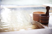 Wooden bucket by a Japanese hot spring bath