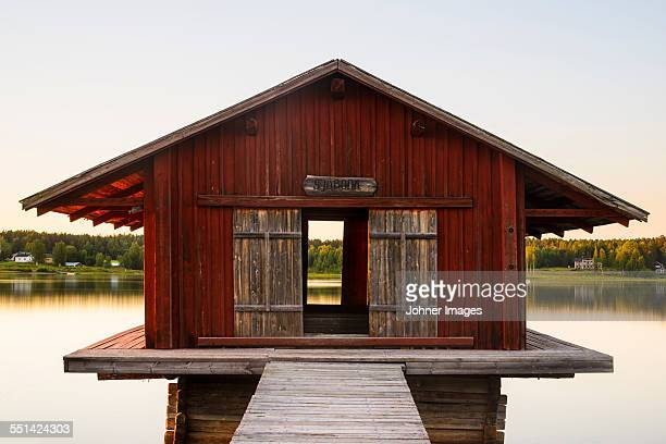 Wooden building at lake