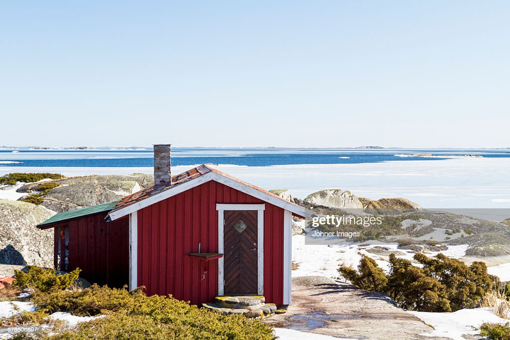 Wooden building on coast