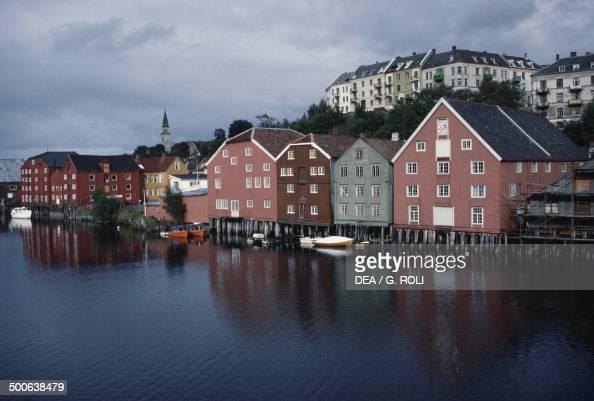 Wooden buildings along the Nidelva river Trondheim SorTrondelag county Norway