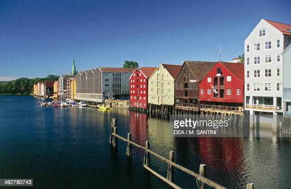 Wooden buildings along the river Nid in Trondheim SorTrondelag County Norway