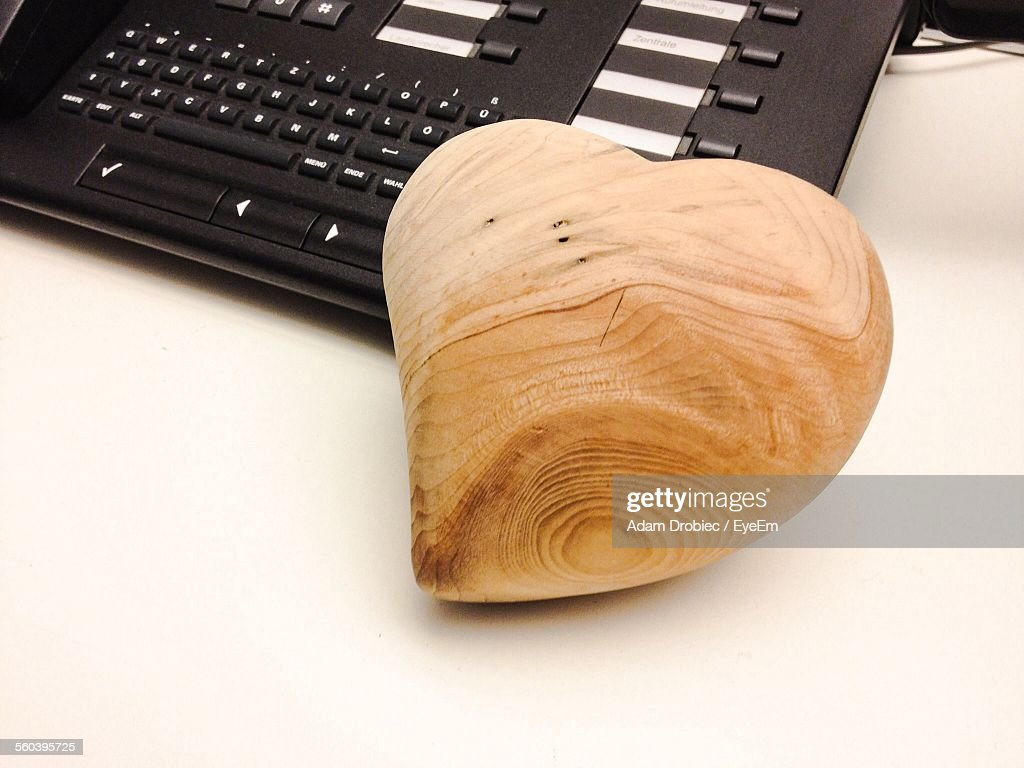 Wooden Carved Heart Shape By Telephone On Table