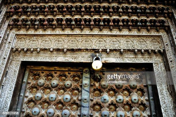 Wooden carving on door of haveli, Fatehpur Shekhawati, Rajasthan, India