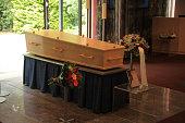 Plain light wooden coffin in a crematorium
