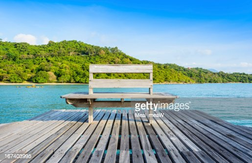 Wooden chair at pier in the sea, Thailand : Stock Photo