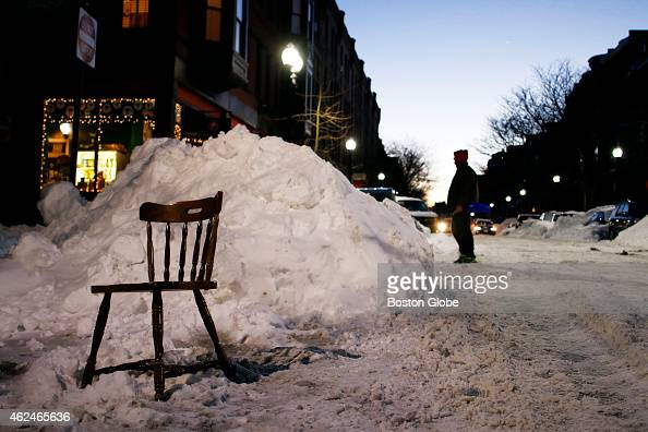 A wooden chair used as a space saver in the South End
