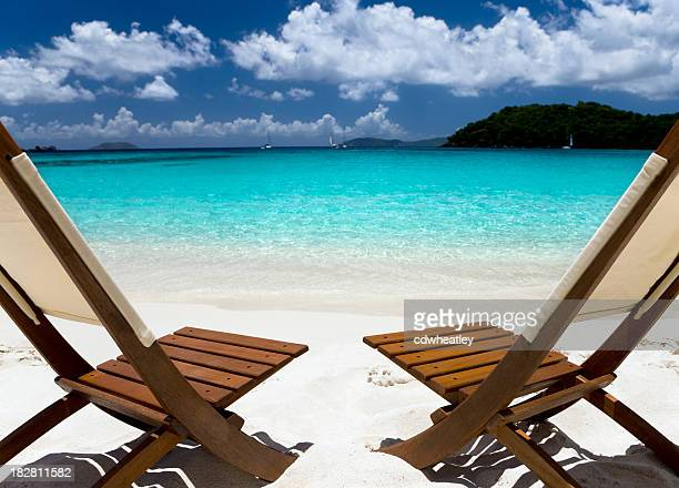 wooden chairs on a beach in the Caribbean