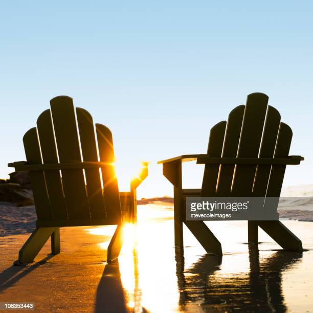 Wooden Chairs on Beach