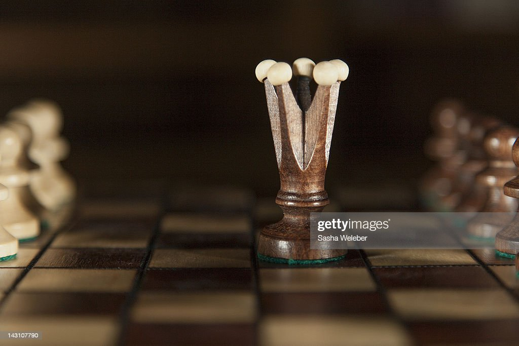 Wooden chess king and pawns : Stock Photo
