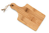 Wooden chopping board, isolated on white, top view.