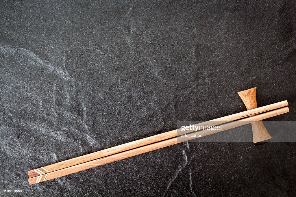 Wooden chopsticks on a stone background : Stock Photo