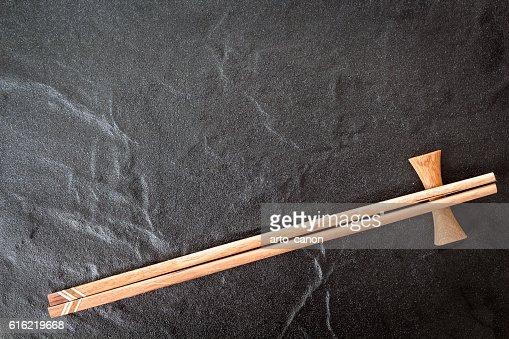 Wooden chopsticks on a stone background : Stock-Foto