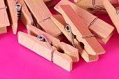 a heap of wooden clothespins lying in the pink studio