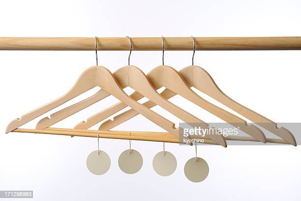 Wooden coat hanger with blank tag against white background