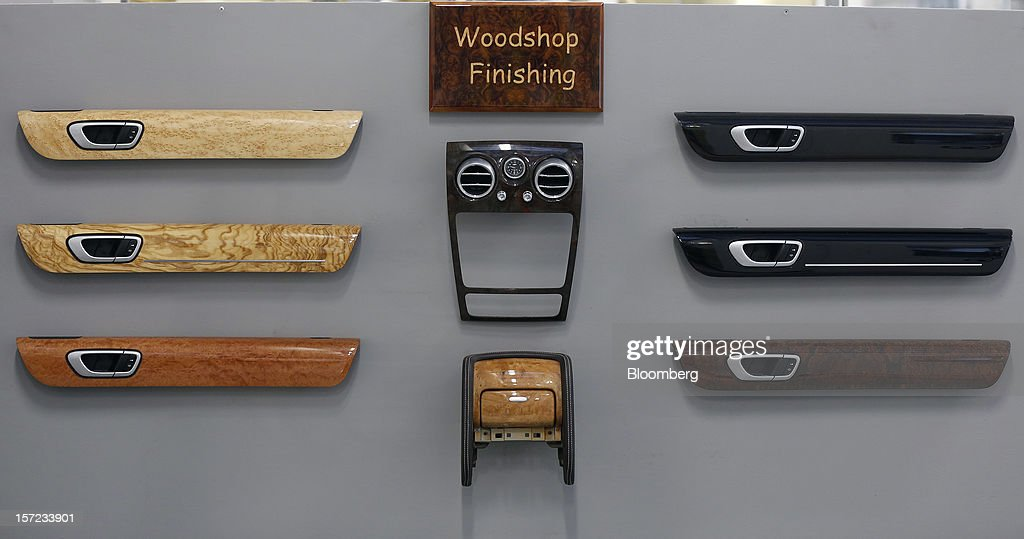 Wooden components for the interior of Bentley automobiles sits displayed on a wall in the woodshop at the Bentley Motors Ltd. workshop in Crewe, U.K., on Thursday, Nov. 29, 2012. Consumer spending and exports propelled the U.K. economy to its fastest growth since 2007 in the third quarter as the Olympics and a post-Jubilee rebound saw household expenditure rise the most in more than two years. Photographer: Simon Dawson/Bloomberg via Getty Images