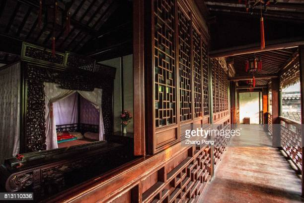 Wooden corridor along the bedrooms on the second floor The Retreat Reflection Garden built in Qing Dynasty is a notable classical garden in China It...