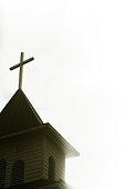 Wooden cross on top of church steeple