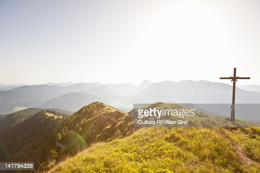 Wooden cross overlooking rural landscape : Stock Photo