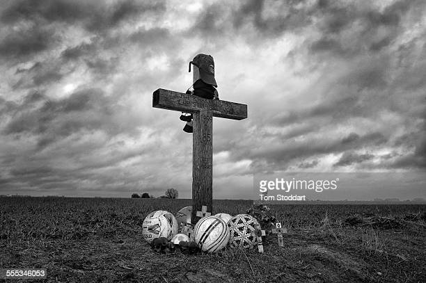 A wooden cross surrounded by footballs marks the field at Ploegsteert Wood Flanders where British and German soldiers played football during the...