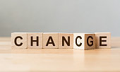 "Wooden cube flip with word ""change"" to ""chance"" on wood table, Personal development and career growth or change yourself concept"