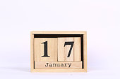 Wooden cubes calendar with the date of January 17. Concept calendar for year with copy space isolated on white background