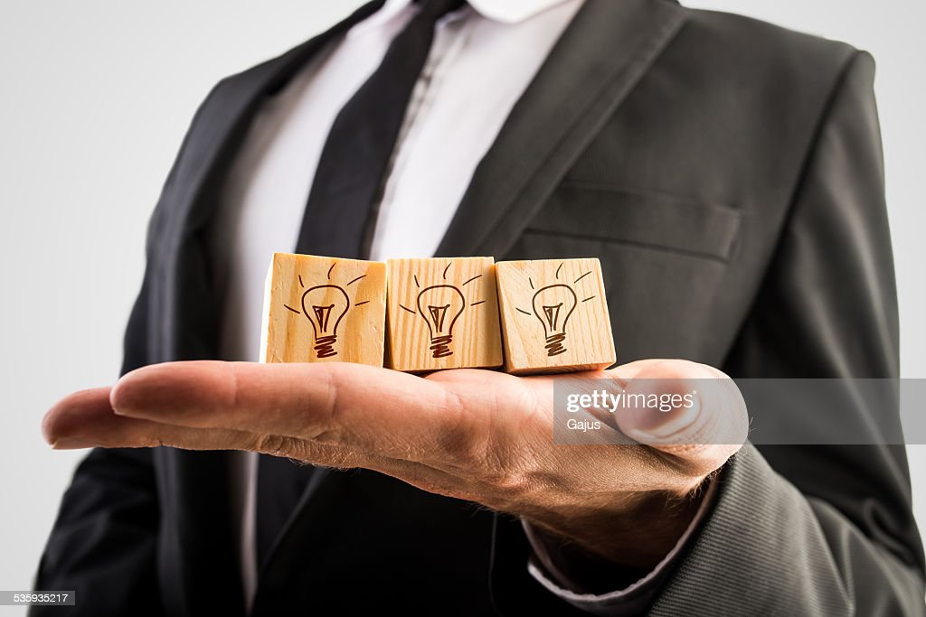Wooden cubes with incandescent light bulbs : Stock Photo