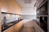 Close-up of wooden cupboards in stylish kitchen