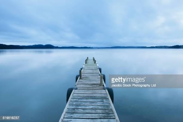 Wooden deck on still lake