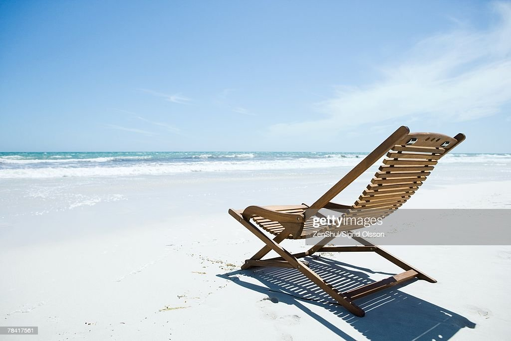 Wooden deckchair on beach : Stock Photo