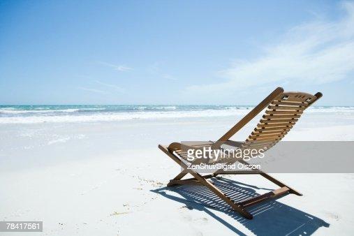 Wooden deckchair on beach