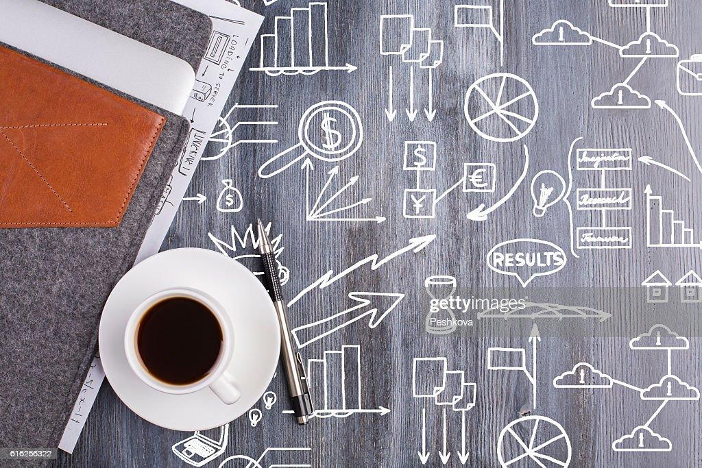 Wooden desktop with business doodles : Stock Photo