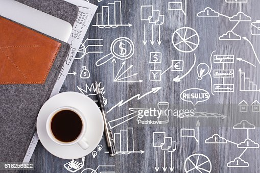 Wooden desktop with business doodles : Stock Photo