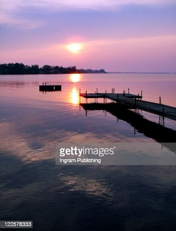 Wooden dock at edge of lake, Sandbanks, Ontario, Canada. : Stock Photo