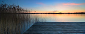 Lake at dusk, old wooden jetty