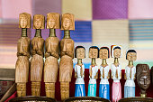 Wooden dolls craft the souvenir of karen long neck village, the symbolic of long neck tribal women at the north of Thailand