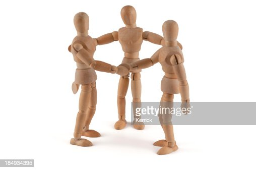Wooden dools holding hands and talking