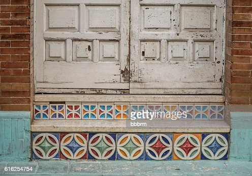 wooden door and steps with colorful tiles : Stock Photo