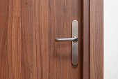 Wooden door with metal knob. Closed entrace to the office.