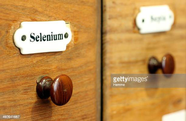 A wooden drawer in pharmacy containing the chemical element Selenium