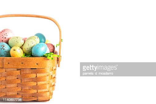 A Wooden Easter Basket Filled with Decorated Eggs Isolated on a White Background : Stock Photo