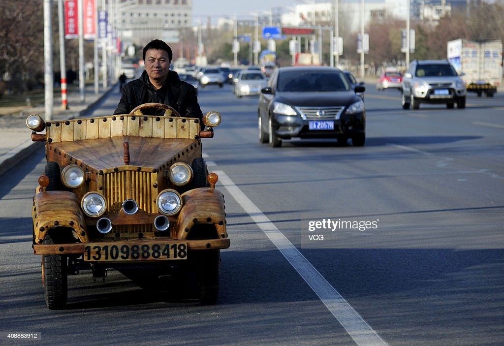 chinese carpenter creates wooden electric car getty images. Black Bedroom Furniture Sets. Home Design Ideas