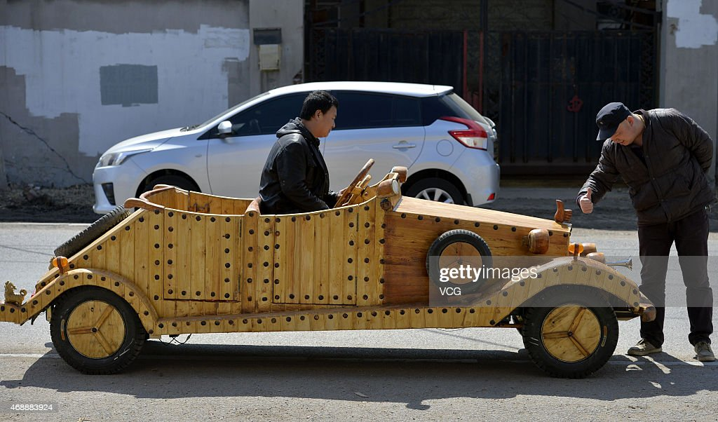 Chinese Carpenter Creates Wooden Electric Car Photos And Images
